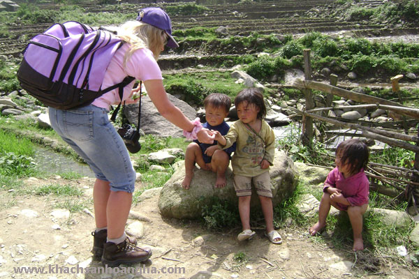 Tourists with local children